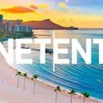 NetEnt logo und waikiki beach Sonnenuntergang